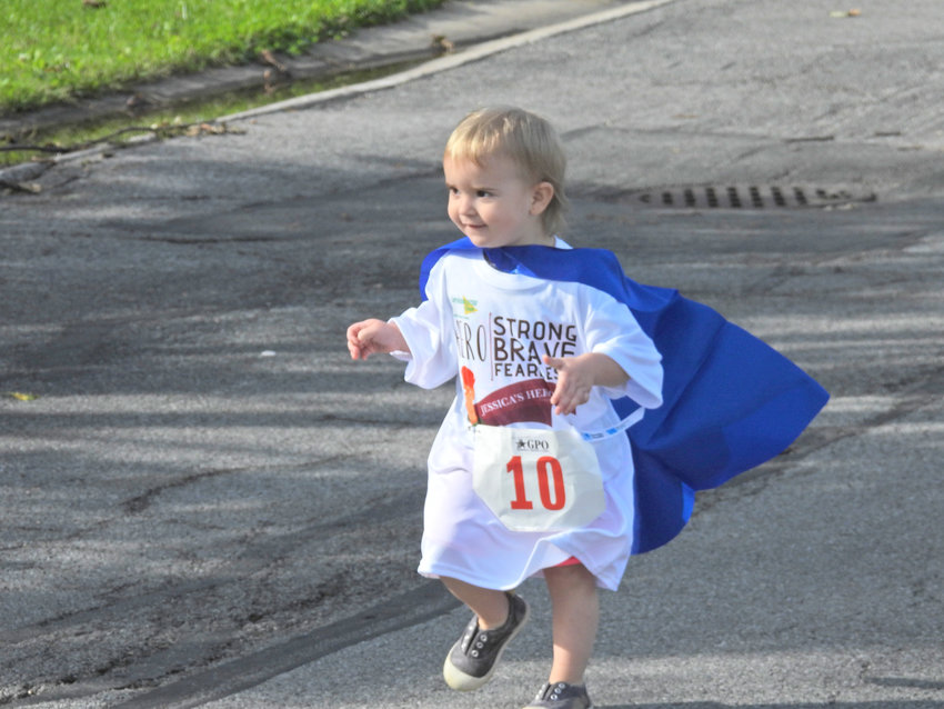 NEVER TOO YOUNG TO BE A HERO — A young child takes off running for Jessica's Heroes 5K Walk and Run, helping raise awareness and support for those in the community fighting cancer.