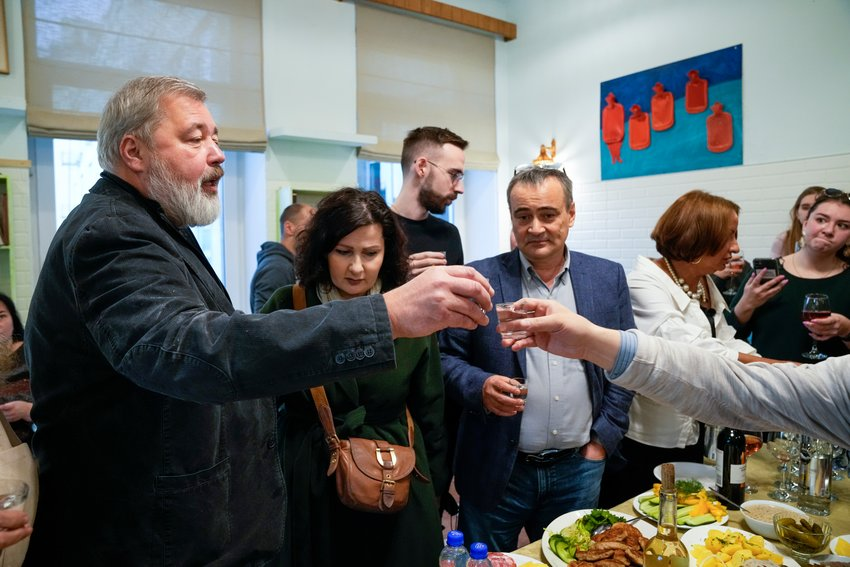 RUSSIAN WINNER — Colleagues toast Novaya Gazeta editor Dmitry Muratov, left, at the Novaya Gazeta newspaper, in Moscow, Russia, Friday. The 2021 Nobel Peace Prize has been awarded to journalists Maria Ressa of the Philippines and Dmitry Muratov of Russia.