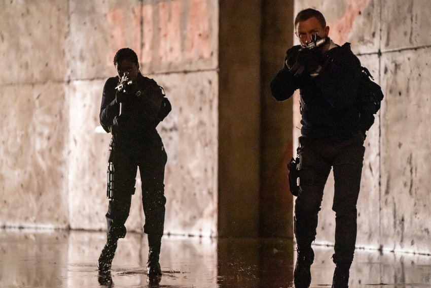 """ACTION FLICK — This image released by Metro Goldwyn Mayer Pictures shows Lashana Lynch, left, and Daniel Craig in a scene from """"No Time To Die."""""""