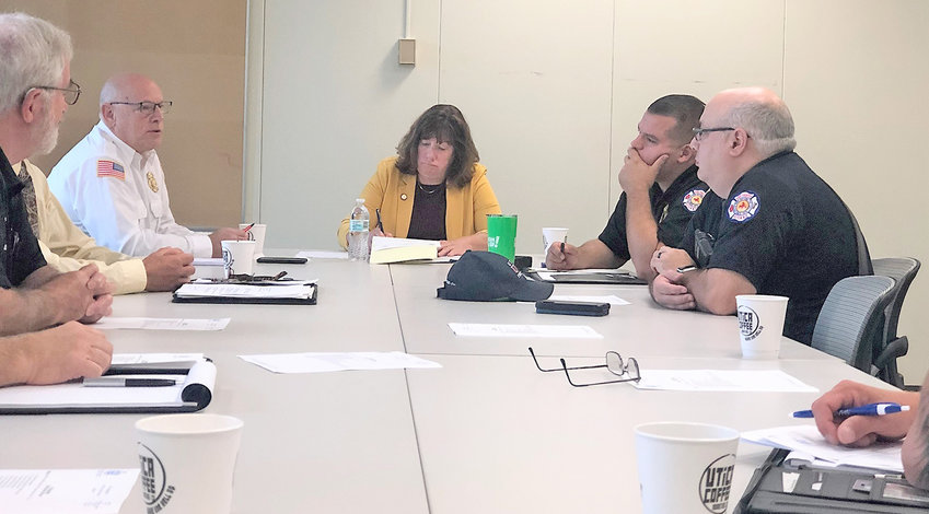 ADDRESSING NEEDS OF FIRST RESPONDERS — Assemblywoman Marianne Buttenschon, D-119, Marcy, meets with emergency service providers at the State Office Building in Utica on Thursday. Buttenschon said the event was an opportunities for EMS groups to share their needs and concerns.