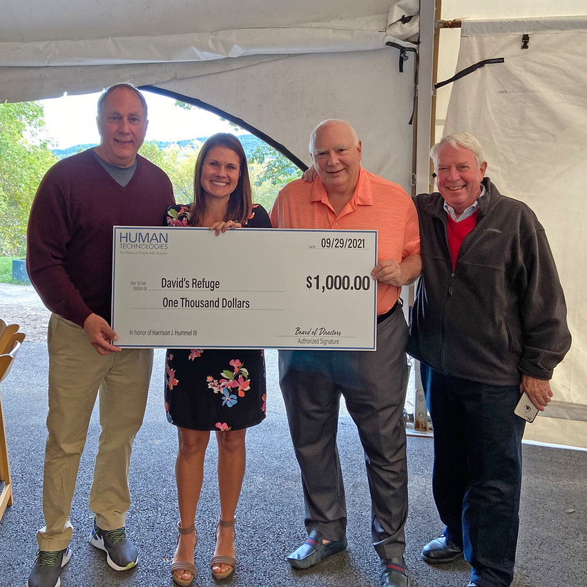 """DONATION —Human Technologies presents a check for $1,000 in Harrison Hummel's name to David's Refuge. From left: Timothy Giarrusso, president/CEO; Kate Houck, executive director of David's Refuge; Harrison """"Chip"""" Hummel; James Stewart, Human Technologies board chair."""
