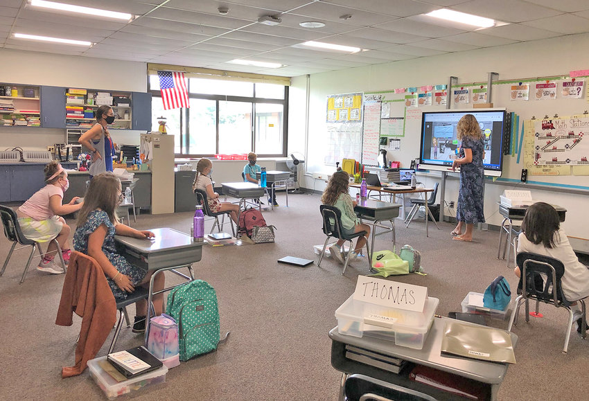 FUNDS FOR TECHNOLOGY — Students at W.A. Wettel Elementary School in Vernon follow a lesson on a smartboard in class in this September 2020 file photo. The district has received a $460,206 grant for additional techology, including the purchase of 1,100 Chromebooks as well as WiFi hotspots.