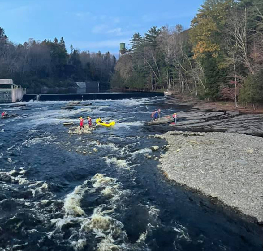 RESCUED ON THE ROCKS —Two teenager fishermen, on the far left, were trapped on the rocks in the West Canada Creek in the Town of Trenton Friday evening, fire officials said. Local volunteer firefighters worked together to launch a swift-water rescue, bringing the teens safely to shore.
