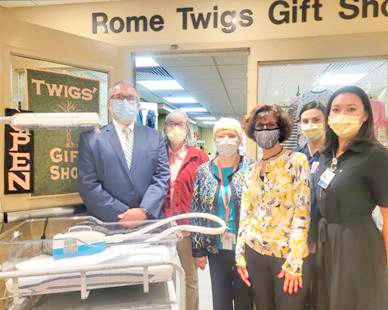 HOSPITAL HELPERS — The Rome Twigs annual Tree of Lights campaign supports the purchase of equipment for Rome Health to help with patient care and comfort, such as the new phototherapy system in maternity to treat newborns with jaundice.  This year's campaign is sponsored by the Rapke Law Firm.  From left, David and Barbara Rapke; Jackie Keys, president of the Twigs; Denise Giardino, from Heather Twig; Leah Imobersteg, NP; and Sara Fleck, RN, maternity nurse manager.