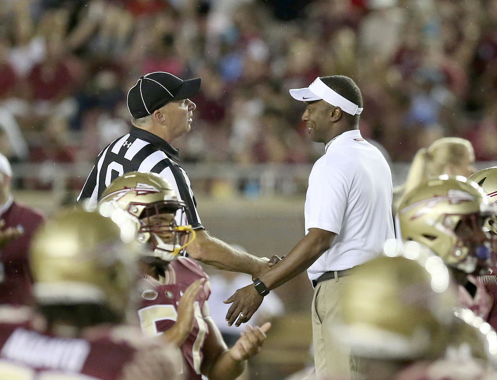 LOOKING TO GET BETTER — Florida State head coach Willie Taggart talks with side judge Angelo Bartis before Saturday's 36-26 loss to Samford in Tallahassee. Taggart and the Seminoles are off to a 1-1 start heading into this weekend's game against Syracuse in the Carrier Dome.  (AP file photo)