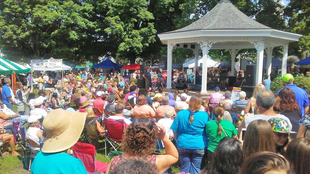 MUSICAL GATHERING — A crowd checks out the musical performance during the Clinton Arts & Musical Festival to be held throughout the village this year from 10 a.m. to dusk Saturday, Aug. 25.(Photo submitted)