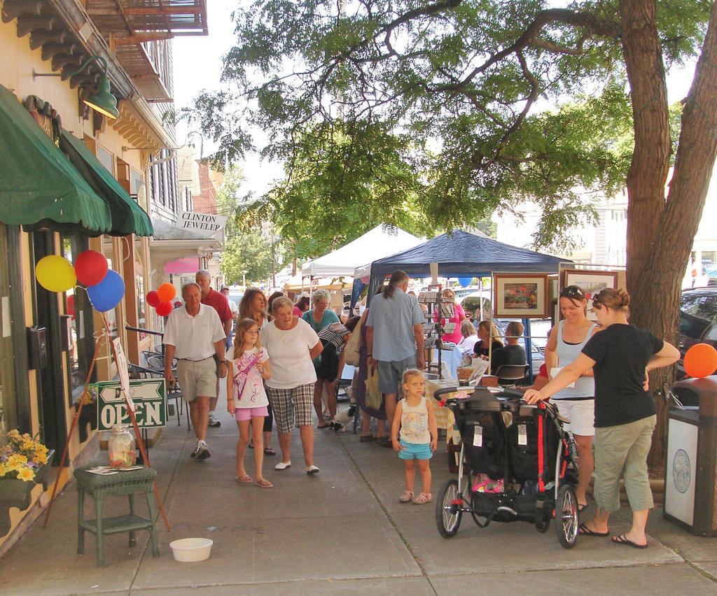 SHOPPERS STROLL — Shoppers walk down Park Row in Clinton to check out all the crafts and wares available for purchase during the Clinton Chamber of Commerce annual Arts & Music Festival.  This year's event will be held Saturday, Aug. 25.