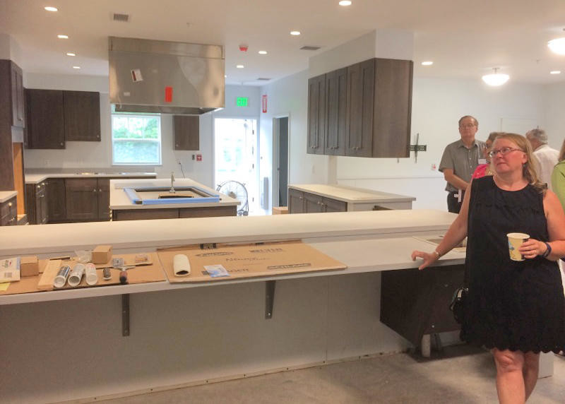 COOKING THINGS UP — Clinton Chamber of Commerce members viewed the main kitchen at Lutheran Homes' Cottages Project off Utica Road, that will serve dementia patients, and is scheduled to open next month.  (Clinton Record photo by Nicole A. Hawley)