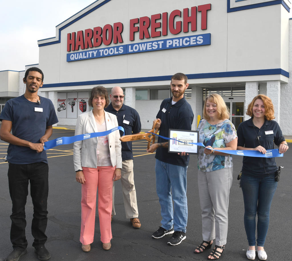 GRAND OPENING — Harbor Freight Tools held its grand opening Tuesday at its store at 5799 Rome-Taberg Road. From left: Desmond Clay, sales; Mayor Jacqueline M. Izzo; Joe Hassell; store manager Eric Cleveland; Rome Area Chamber of Commerce representative Sue McLoughlin; and manager Silvie Castelluccio.  (Sentinel photo by John Clifford)