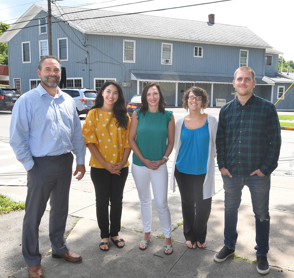 FAB FIVE — The Brockett Creative Group, from left, Matthew Brockett, Juliana Santucci, Catrina Dibble, Andrea Crissey and PJ Lang. Across the street is the building they work out of in Clinton.  (Clinton Record photo by John Clifford)