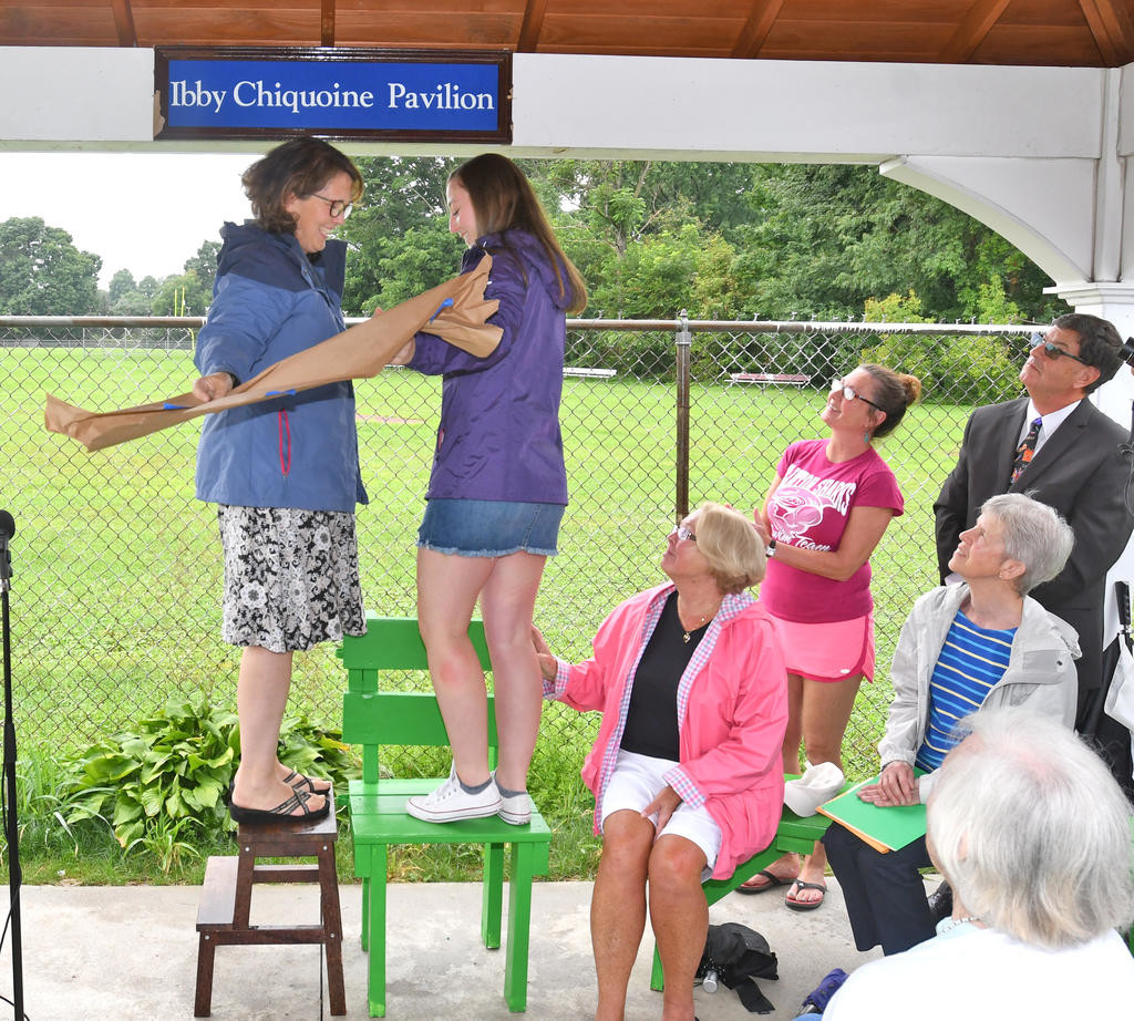 THE GREAT REVEAL — Kate Chiquoine Stamm, left, and her daughter Hannah Stamm unveil the plaque on the new pavilion at Clinton's Jack Boynton Community Pool Aug. 11.  (Clinton Record photo by John Clifford)
