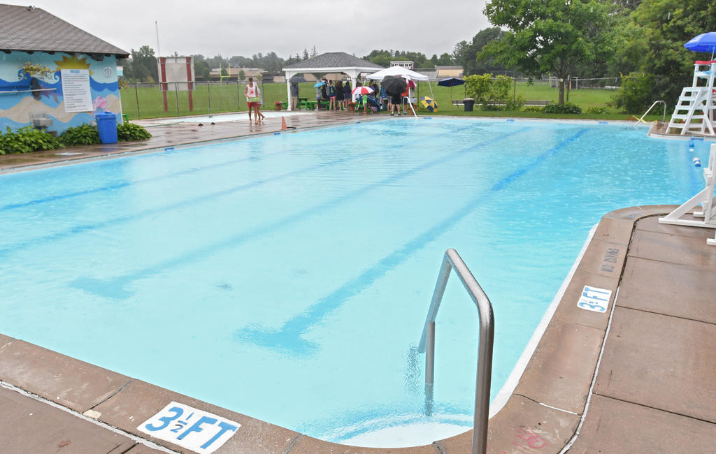COMMUNITY POOL — Clinton's Jack Boynton Community Pool is pictured on Aug. 11. The gazebo on the other side of the pool is what was being dedicated.  (Clinton Record photo by John Clifford)