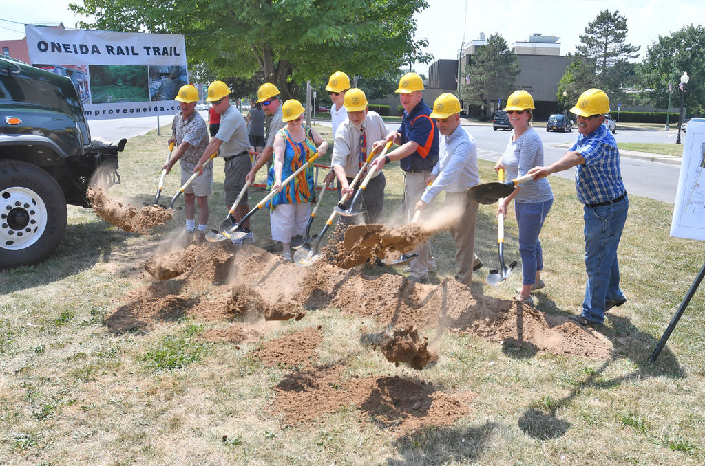 TRAIL BREAKS GROUND — The City of Oneida broke ground on the Oneida Rail Trail on July 16. Pictured from left are: Al Cohen, city Common Council; Jim Chamberline, deputy mayor; Scott Ingmire, Madison County Planning Department; Helen Acker, city Common Council; Eric Schuler, city engineer; Leo Matske, mayor; Luke Griff, Parks Department director; Mark Scimone, Madison County administration; Jamie Kowalszk, Madison County Planning Department; and Joe Magliocca, city of Oneida supervisor.  (Sentinel photo by John Clifford)