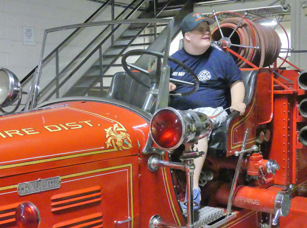 OLD SCHOOL — Joey Abt sits behind the wheel of a classic 1931 Ward laFrance fire truck, the first truck purchased by the Lee Center Fire Department. (Sentinel photo by Sean Mills)