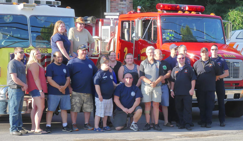 BUCKET LIST FULFILLED — Joey Abt, center, poses with firefighters and EMTs from Lee Center, Lake Delta, Taberg, Camden and AmCare Ambulance during his visit to the Lee Center Fire Department Tuesday evening.