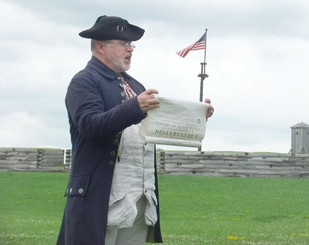 CELEBRATING INDEPENDENCE — A historical re-enactor reads the Declaration of Independence at Fort Stanwix National Monument in this file photo. Readings of the Declaration of Independence will take place at 11 a.m. and 1 p.m., followed by salutes to the new nation.  (Photo submitted)