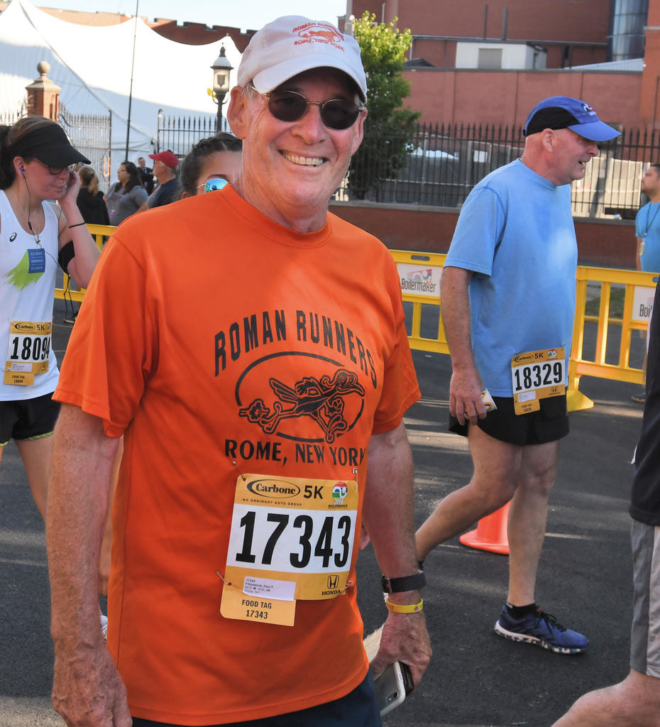 ALL-SMILES — Rome runner and Rome School Board member Paul Fitzpatrick at the conclusion of the Boilermaker 5k Road Race on Sunday.  (Sentinel photo by John Clifford)