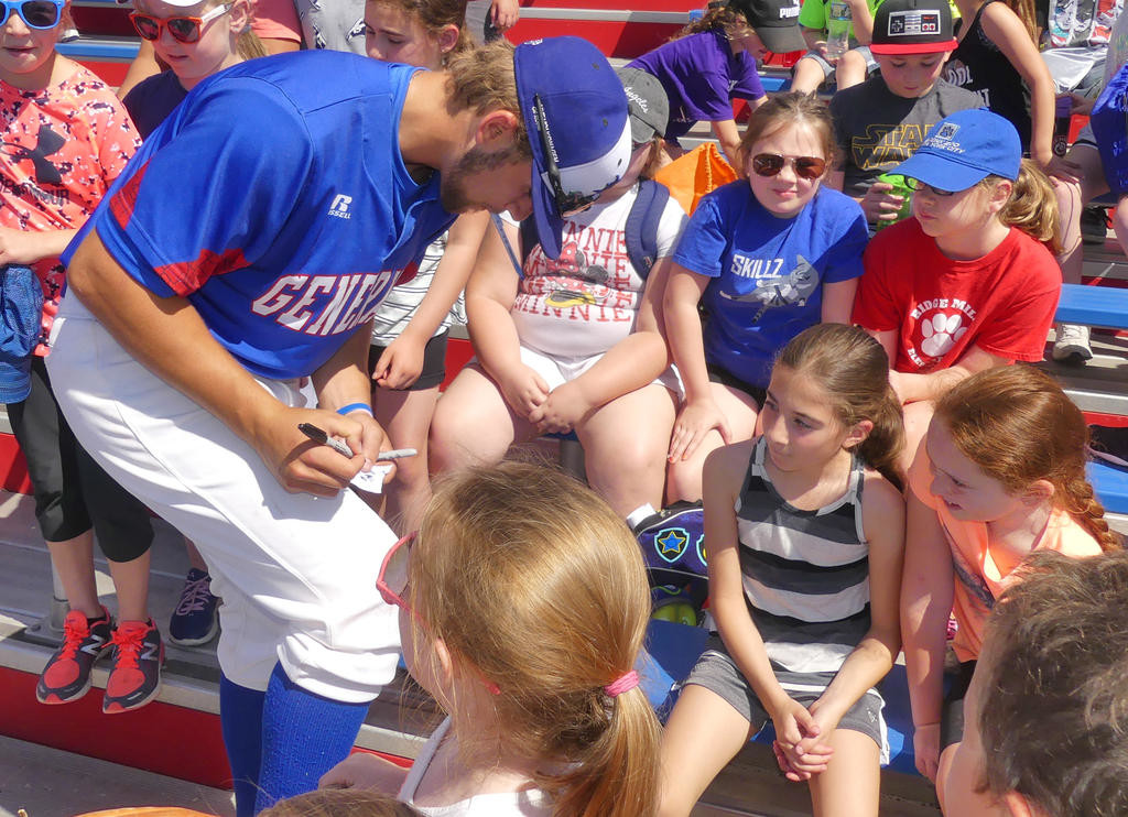 HOMETOWN FAVORITE — Rome Free Academy graduate and Rome Generals third baseman Derrick Miller signs autographs for Ridge Mills girls prior to the start of Tuesday morning's game against the Sherrill Silversmiths at DeLutis Field.  (Sentinel photo by John Clifford)