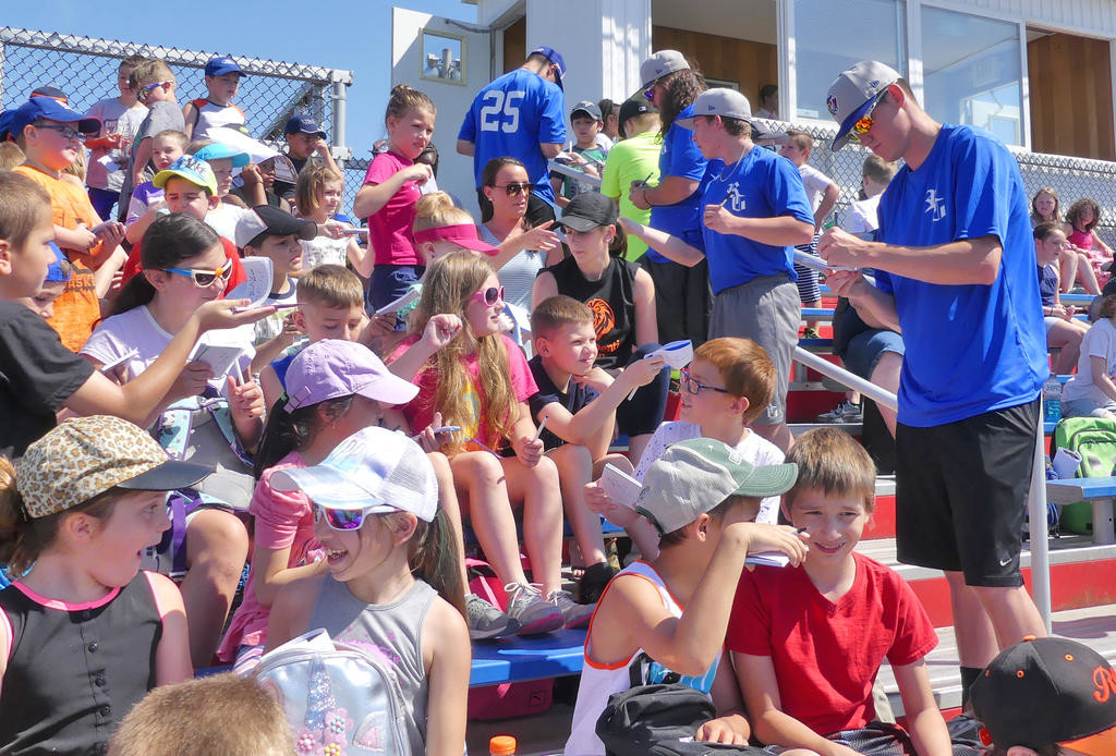 DAY AT THE BALLPARK — Rome Generals baseball players go into the stands to sign autographs for Denti Elementary school third graders before their game with the Sherrill Silversmiths on Tuesday morning at DeLutis Field.  (Sentinel photo by John Clifford)