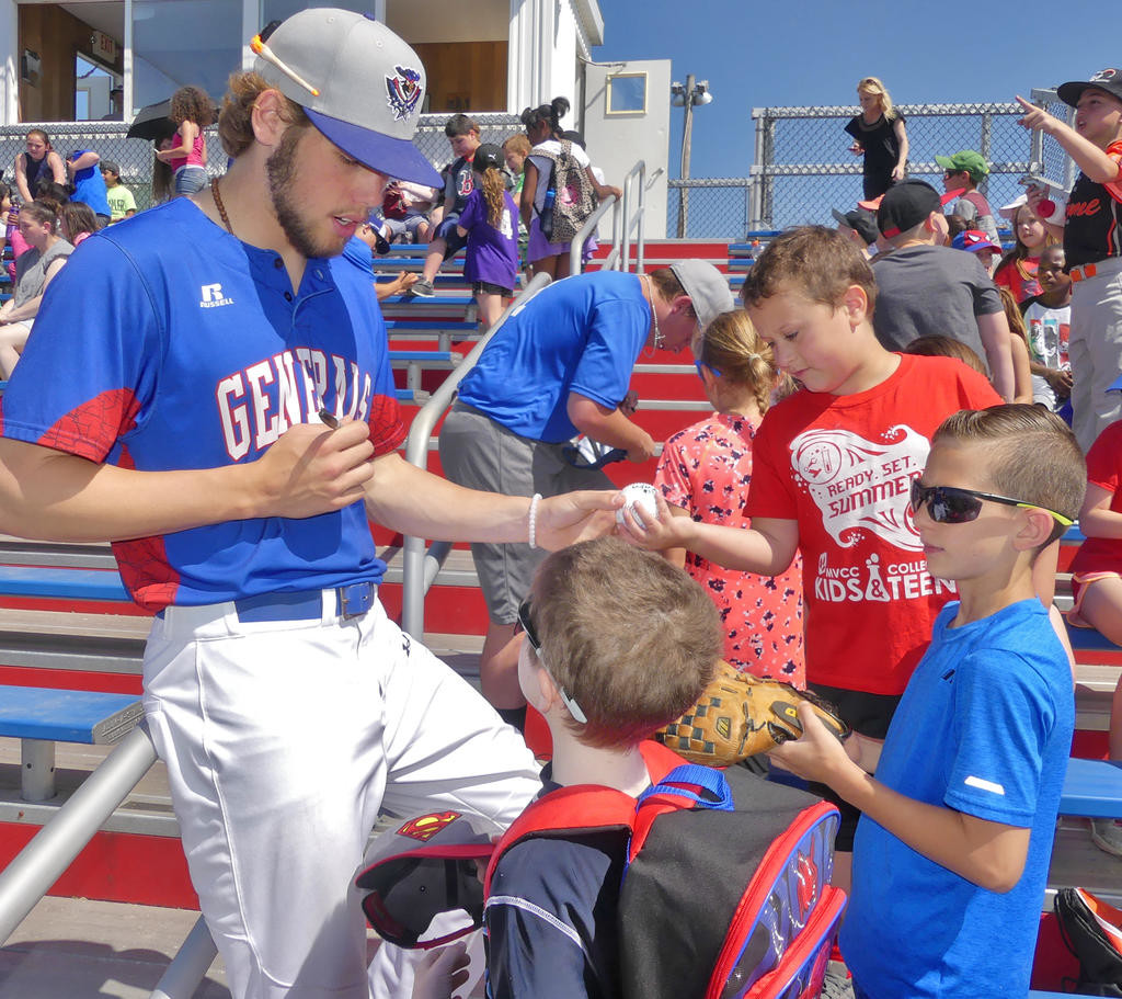 AUTOGRAPH SIGNING — Rome Generals outfielder Chris DeGiacamo hands back a baseball to Ridge Mills third grader Zachary Spaeth as he signed autographs for Ridge Mills and Denti students on kids day at DeLutis Field.  (Sentinel photo by John Clifford)