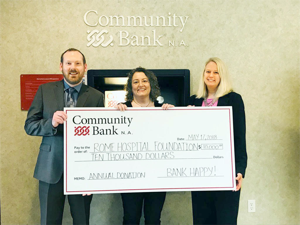HOSPITAL SUPPORT — Dean M. Shlotzhauer Jr., left, commercial banking officer and Wendy J. Berg, manager of the Turin Road and Griffiss Park Branches of Community Bank N.A., present a check for $10,000 to Becky D'Aiuto, executive director of the Rome Hospital Foundation. Rome Hospital Foundation works to provide financial support and ambassadorship to Rome Memorial Hospital.  (Photo submitted)