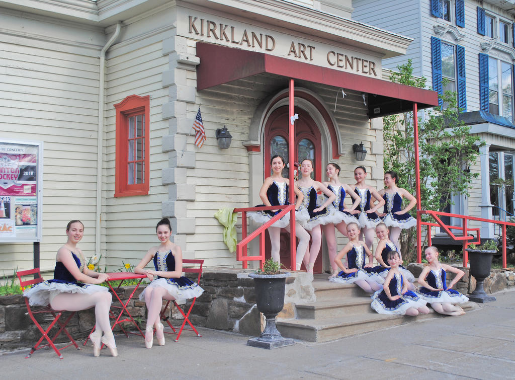 SPRING IN THEIR STEP — A group of Spring Dance Performance dancers strike a pose on the steps of the Kirkland Art Center  (Photo by Tim Rand)