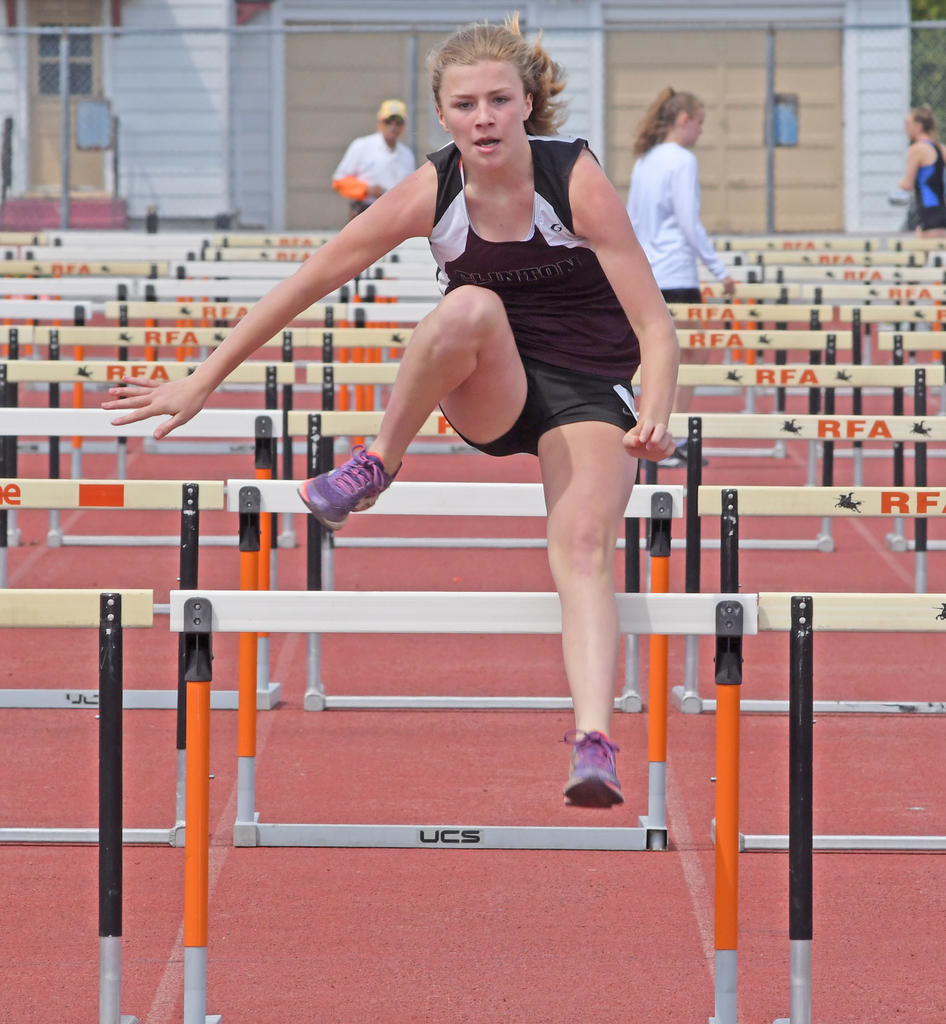 UP AND OVER — Clinton eighth-grader Finley Davignon hops over the hurdles during her run of the pentathlon on May 5 in the 65th annual Copper City Classic at Rome Free Academy Stadium. Davignon finished sixth overall.  (Clinton Record photo by John Clifford)