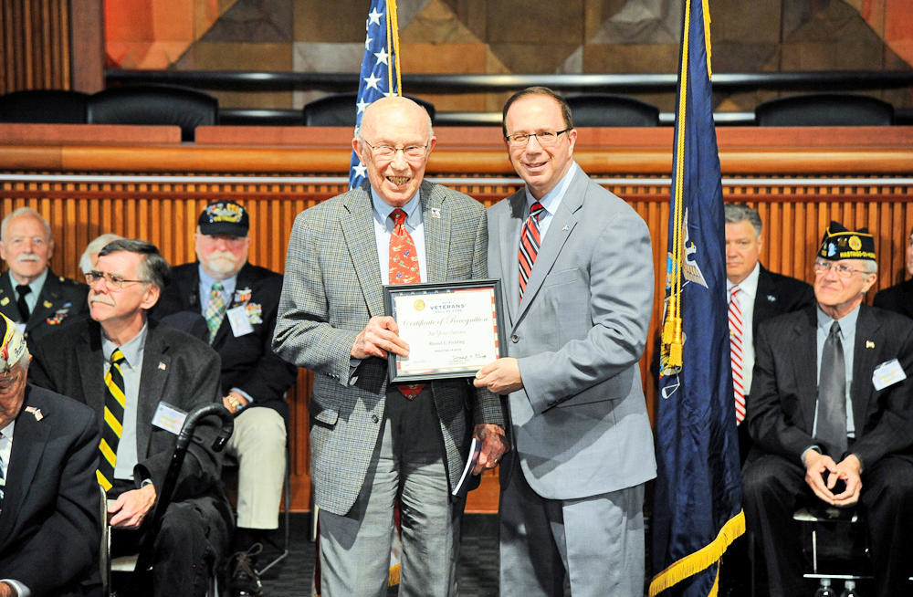 HONORED FOR SERVICE — Russel Fielding, left, a commissioned officer in the Army in World War II and 1st Lieutenant during the Korean Conflict, is honored by State Sen. Joseph A. Griffo, R-47, Rome, during a ceremony Tuesday in Albany. Fielding, of New Hartford, was inducted into the New York State Senate Veterans' Hall of Fame.  (Photo submitted)