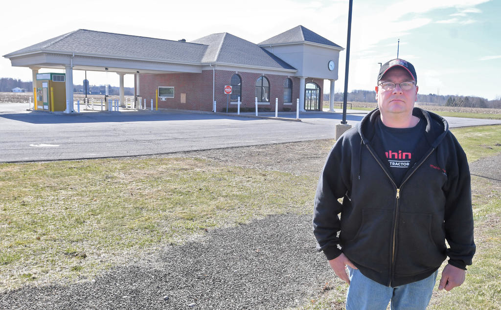 NEW LOCATION AHEAD — The former Berkshire Bank branch at 6310 Elmer Hill Road is set to be purchased by the Hobby Hill Farm Sales business, which plans to relocate from a nearby 8727 Turin Road site. Standing in front of the former bank branch is Todd Bortiatynski, who operates Hobby Hill Farm Sales with his wife Claire while his brother Michael is a business partner.  (Sentinel photo by John Clifford)