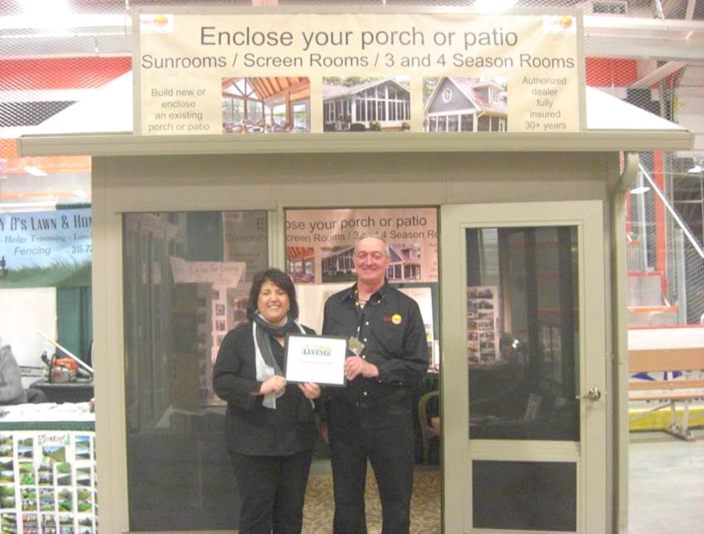 OUTSTANDING BOOTH — Brian Townsend of Townsend Sunspace Sunrooms, 810 Sherman Ave., accepts one of the three awards from the Rome Area Chamber of Commerce for Outstanding Booths at the 43rd annual Rome Home Expo. Presenting is Franca Armstrong, chamber board chair.  (Photo submitted)