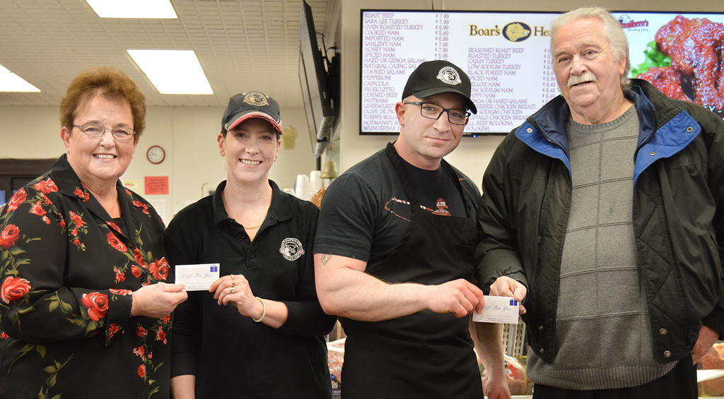 "MEAT TREAT — Mazzaferro's Meat & Deli, 7824 Ridge Mills Road, supported Rome and the surrounding communities with its ""All About the Meat"" contest which ended March 31 with over 5,000 entries. Pictured, from left, are: Grand Prize winner Mary E. Smith, of Camden; Heather Brown, store manager; Brandon Ferrare, Meat Department manager and 'The Face' of Mazzaferro's; and Grand Prize winner Joseph Dale, of Rome.  (Sentinel photo by Kenny Kudrewicz)"
