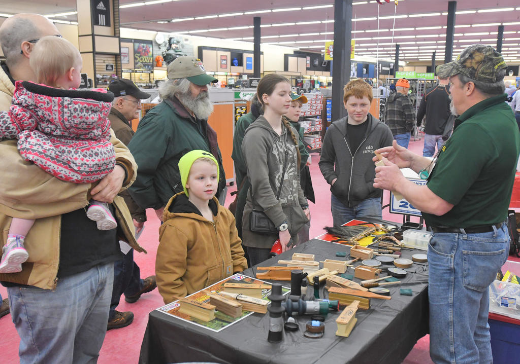 TALKING TURKEY — People flock to the Quaker Boy Game Calls booth to listen to — and try their luck at — different turkey calls during Herb Philipson's 14th Annual Spring Outdoorsman's Show at its New Hartford store on Saturday.  (Sentinel photos by John Clifford)