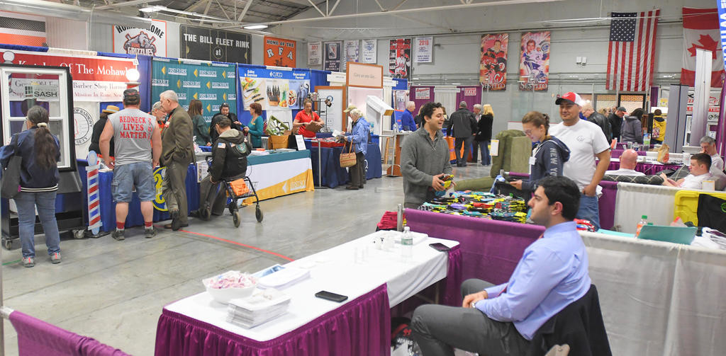 CHECKING THINGS OUT — People stop by vendor booths on Saturday afternoon at the Rome Home Expo.  (Sentinel photo by John Clifford)