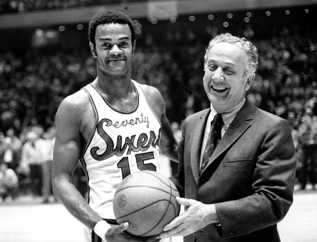 BASKETBALL GREAT DIES — In this Jan. 29, 1971, file photo, Hal Greer, left, accepts a ball from Sixers owner Irv Kosloff after Greer reached 20,001 points during a basketball game against the Bucks in Philadelphia. Greer, a Hall of Fame guard and the 76ers' career leading scorer, died Saturday at the age of 81.  (AP file photo)