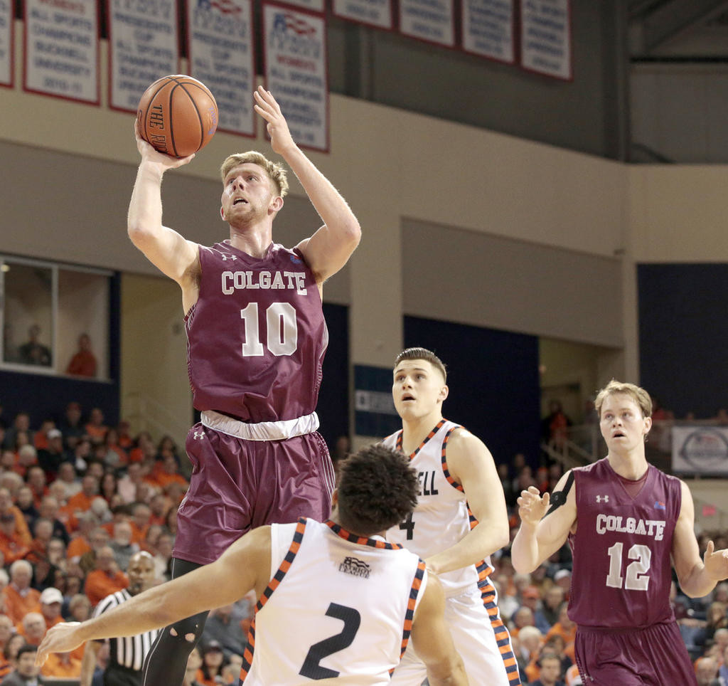 WAY UP THERE — Colgate's Will Rayman shoots over Bucknell's Stephen Brown during Wednesday night's Patriot League title game in Lewisburg, Pa. Rayman had a team-high 17 points for the Raiders in their 83-54 defeat.  (AP Photo)