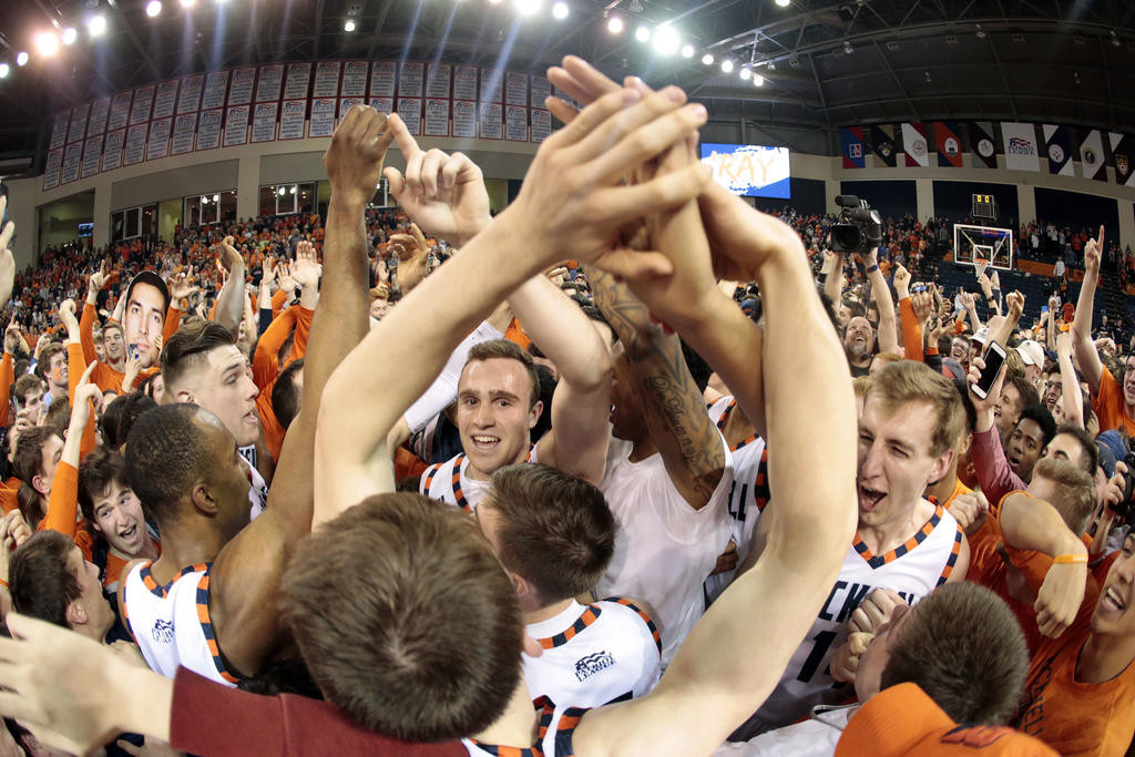 BACK TO THE NCAA TOURNEY — Bucknell players and fans celebrate following Wednesday night's 83-54 victory over Colgate in the Patriot League championship game in Lewisburg, Pa. Bucknell is headed to the NCAA tournament for the second straight year.  (AP Photo)