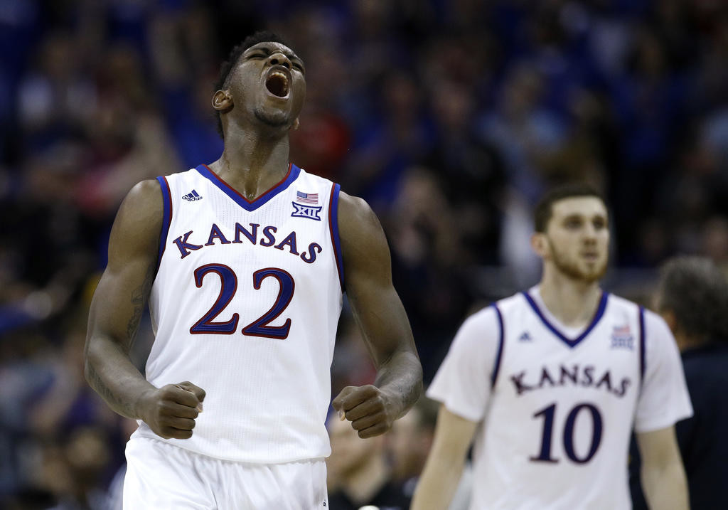 BIG 12 CHAMPS — Kansas player Silvio De Sousa, left, celebrates during the second half of Saturday's 81-70 win over West Virginia in the Big 12 Conference Tournament championship game in Kansas City, Mo. The Jayhawks are seeded No. 1 in the Midwest Regional.  (AP Photo)