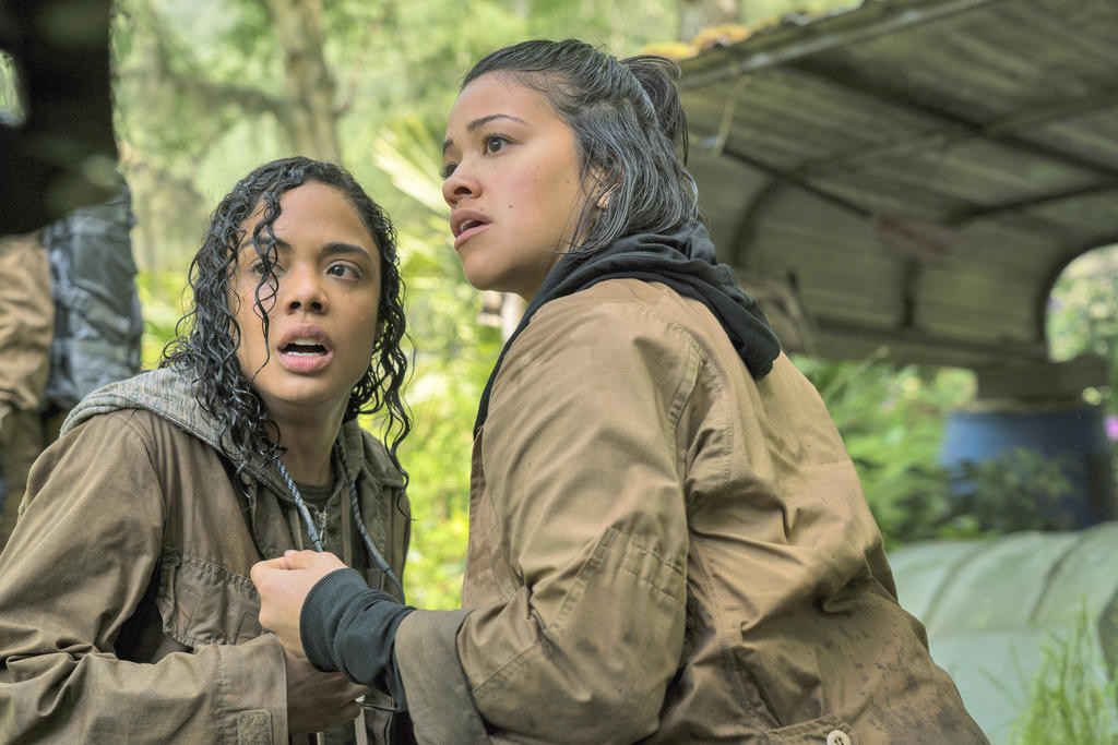 "UNDER THREAT — Tess Thompson, left, and Gina Rodriguez in a scene from ""Annihilation.""  (Paramount Pictures/Skydance via AP)"