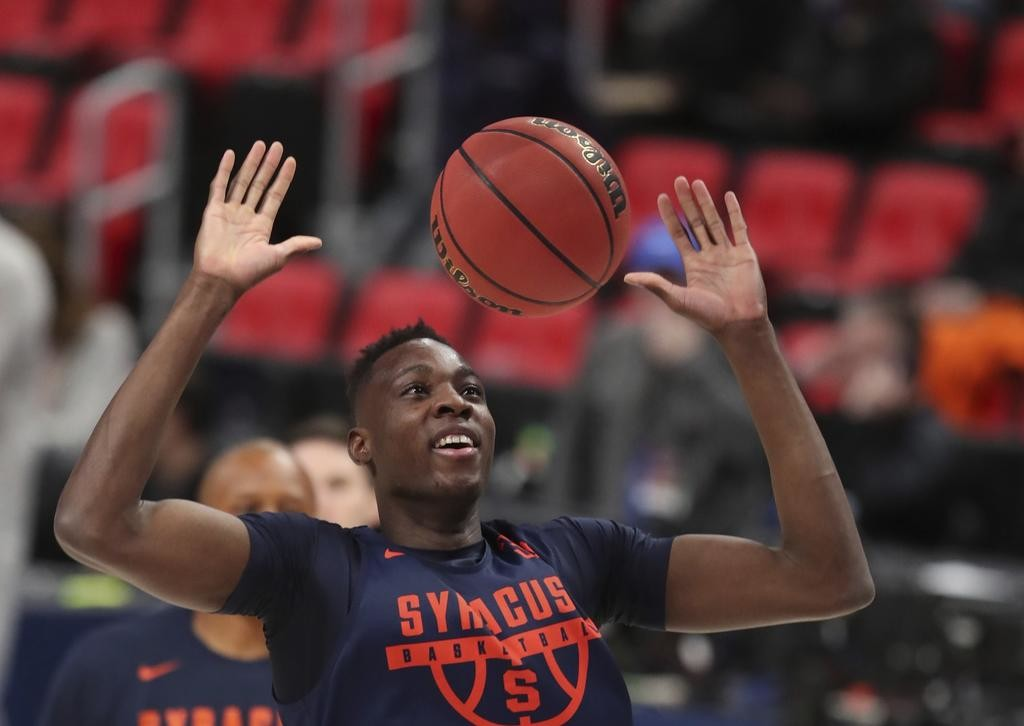 STAYING LOOSE — Syracuse forward Bourama Sidibe smiles during a practice session on Thursday in Detroit in preparation for tonight's NCAA Tournament Midwest Regional first-round game against TCU.  (AP Photo)