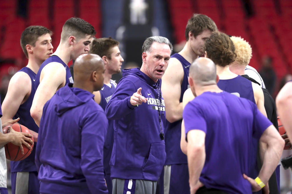 LISTEN UP — TCU head coach Jamie Dixon talks to his team after a practice session on Thursday in preparation for tonight's NCAA Tournament Midwest Regional first-round game against Syracuse in Detroit.  (AP Photo)