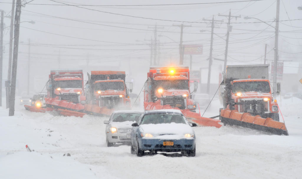 SNOW GOING — A quartet of Rome DPW plows clear snow from Erie Boulevard Wednesday afternoon. The National Weather Service said between six and nine inches fell throughout the Mohawk Valley during the storm. Up to three inches of snow are expected on Friday.  (Sentinel photo by John Clifford)