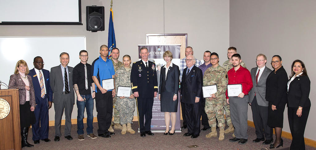 SOLDIERS COMPLETE TECHNICIAN TRAINING — Soldiers from the Army's Fort Drum base attend a graduation for an advanced manufacturing technician training program in conjunction with SUNY Polytechnic Institute and other area colleges.  (Photo submitted)