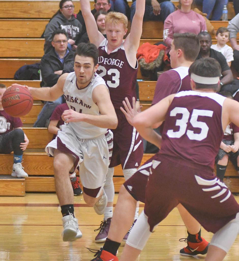 DRIVING TO THE BASKET — Oriskany's Richard Phelps, middle, drives toward the basket with Old Forge's Josh Kelly, back, Shane Hulser, right, and Jimmy Connell, front, during Thursday night's Center State Conference Division IV contest in Oriskany. Phelps recorded a triple-double of 16 points, 10 rebounds and 10 assists in Oriskany's 62-53 victory.  (Sentinel photo by John Clifford)