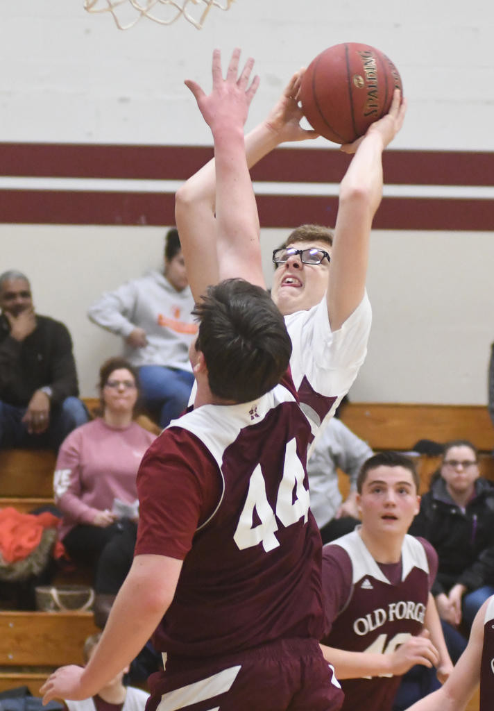 PUTTING IT UP — Oriskany's Aaron Warcup, back, goes over Old Forge's Waddie Kalil during Thursday night's Center State Conference Division IV matchup in Oriskany.  (Sentinel photo by John Clifford)