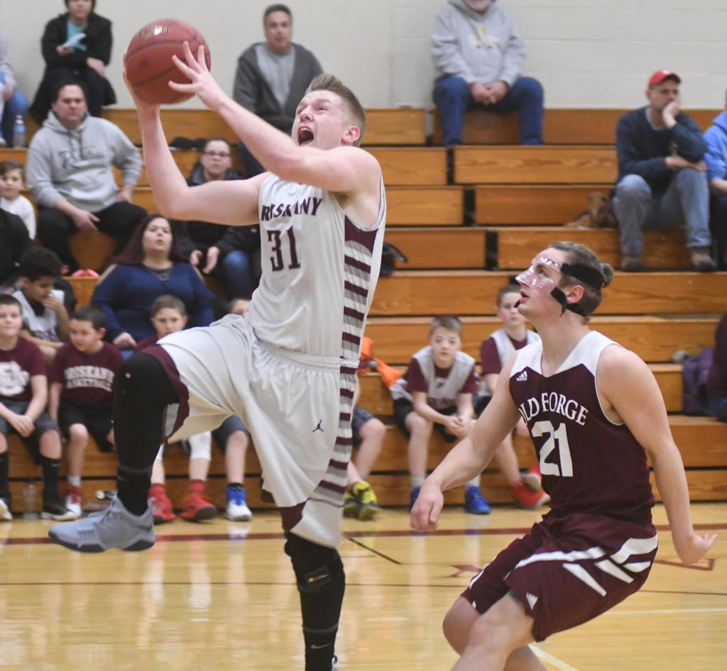 LAYING IT UP — Oriskany's Brandon Reid goes in for two followed by Old Forge's Tyler Kearns during Thursday night's CSC-IV battle. Oriskany won, 62-53.  (Sentinel photo by John Clifford)