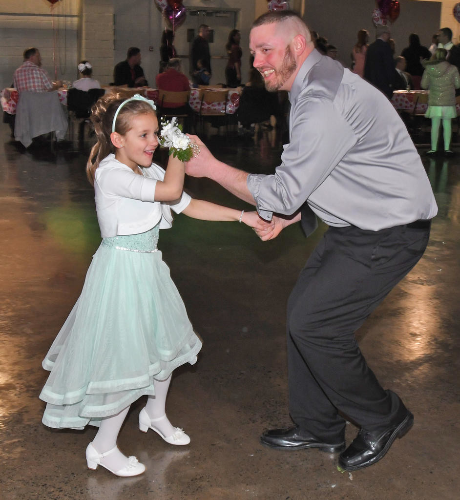 STEPPING OUT — Ryan Panych dances with his 6-year old daughter, McKinley, during the City of Rome Recreation Department's Sweet Heart Dance.