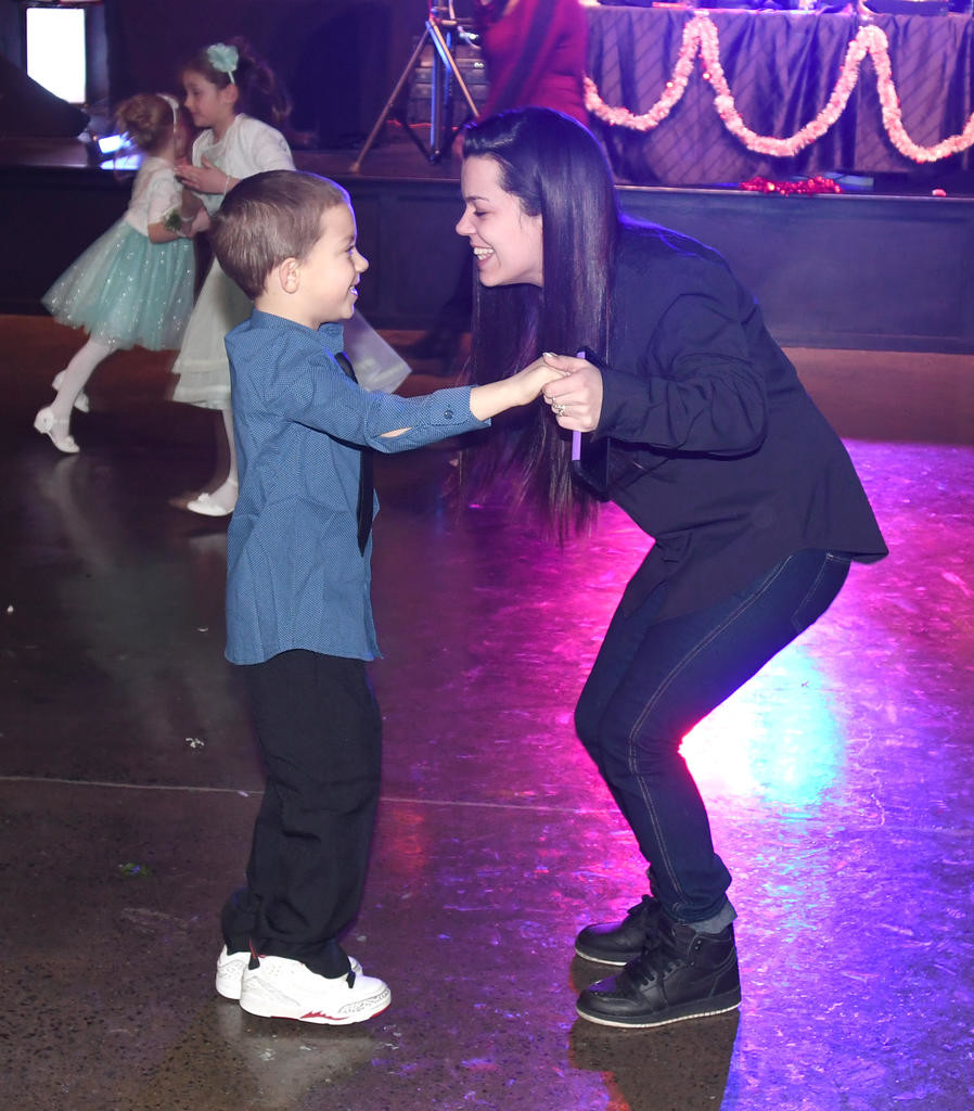 ENJOYING A NIGHT OUT — Stephanie Rienzo and her son, Joshua, 8, dance the night away during the City of Rome Sweet Heart Dance at the Life Church.