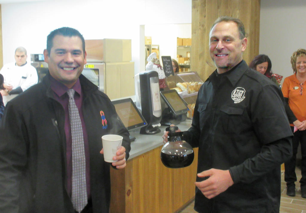 TOP O' THE MORNING — Ben Hibbert, left, shares a coffee with Utica Coffee President Frank Elias during the opening of the Maple Leaf Market in Sherrill. The Oneida Indian Nation has teamed with various local businesses to bring fresh food to the market. The nation plans to open four more Maple Leaf Markets in Oneida and Madison counties beginning with a second store in Chittenango in late February.  (Sentinel photo by Roger Seibert)