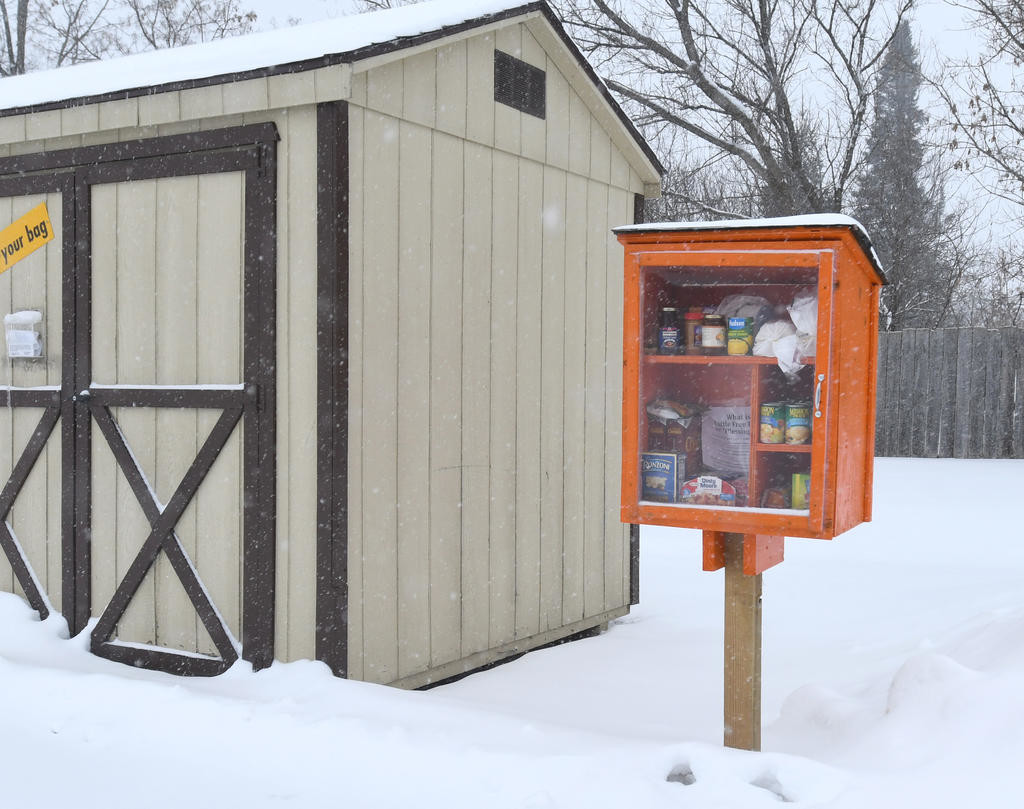 NEIGHBORS HELPING NEIGHBORS — A Blessing box sits next to a clothing drop off shed at the Verona Fire Department on Volunteer Avenue today. People are invited to place food and toiletry items inside for others to take when needed.  (Sentinel photo by John Clifford)