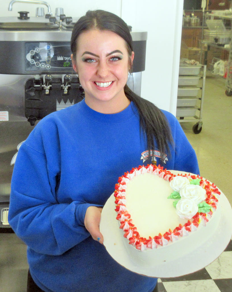 HEARTS TO YOU — Nicky Doodles Operations Manager Stephanie Conroy holds a heart-shaped ice cream cake that was made for Valentine's Day.  (Sentinel photo)